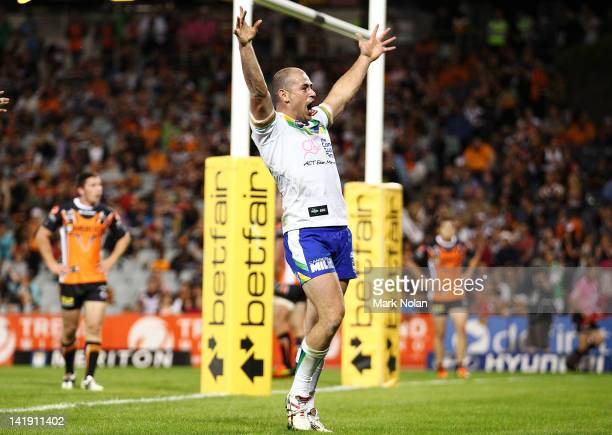 Terry Campese of the Raiders celebrates his try during the round four NRL match between the Wests Tigers and the Canberra Raiders at Campbelltown...