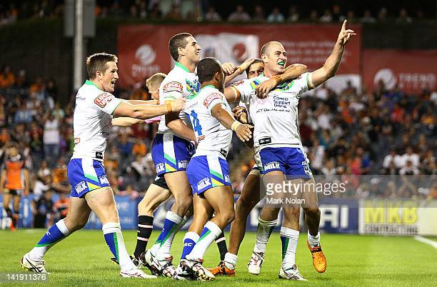 Terry Campese of the Raiders celebrates his try with team mates during the round four NRL match between the Wests Tigers and the Canberra Raiders at...