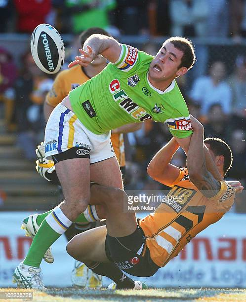 Terry Campese of the Raiders offloads during the round 15 NRL match between the Wests Tigers and the Canberra Raiders at Leichhardt Oval on June 20,...
