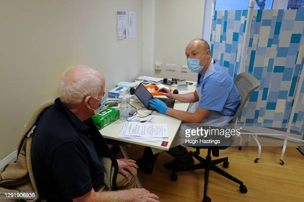 Terry Carter before receiving his Covid-19 vaccination from Dr Jan Knobloch at the Bodmin Treatment Centre Covid-19 vaccination clinic on December...