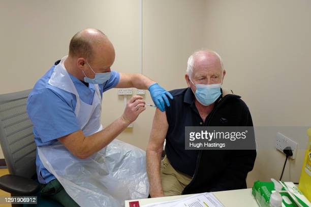 Terry Carter receives his Covid-19 vaccination from Dr Jan Knobloch at the Bodmin Treatment Centre Covid-19 vaccination clinic on December 17, 2020...