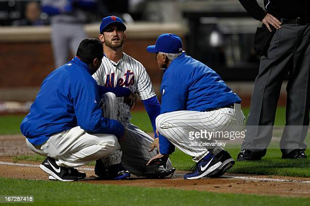 Terry Collins of the New York Mets talks toJonathon Niese of the New York Mets after he was hit by a comebacker hit by Mark Ellis of the Los Angeles...