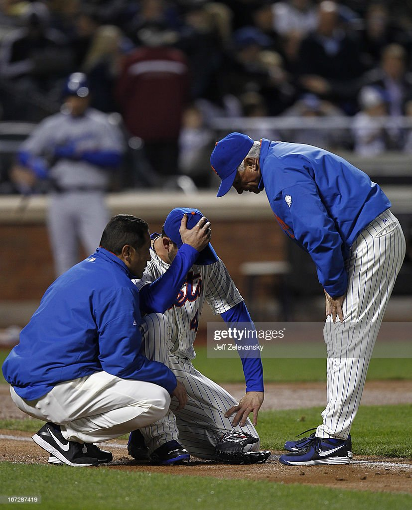 Terry Collins #10 of the New York Mets talks toJonathon Niese #49 of the New York Mets after he was hit by a comebacker hit by Mark Ellis #14 of the Los Angeles Dodgers at Citi Field in the Flushing neighborhood of the Queens borough of New York City. Niese left the game.