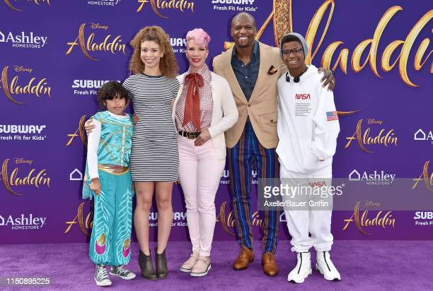 Terry Crews and family Miley Crews Naomi BurtonCrews Rebecca KingCrews and Isaiah Crews attend the premiere of Disney's Aladdin on May 21 2019 in Los...