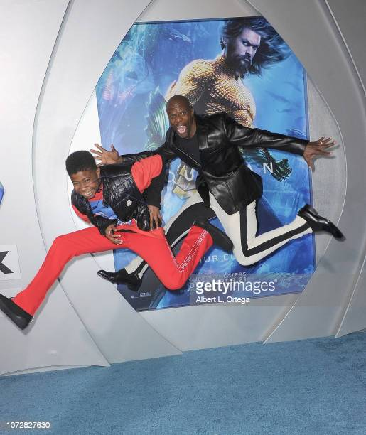 Terry Crews and Isaiah Crews arrive for the Premiere Of Warner Bros Pictures' Aquaman held at TCL Chinese Theatre on December 12 2018 in Hollywood...