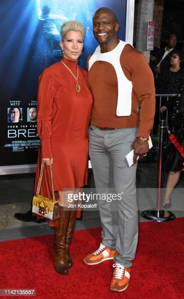 Terry Crews and Rebecca Crews attend the premiere of 20th Century Fox's Breakthrough at Westwood Regency Theater on April 11 2019 in Los Angeles...