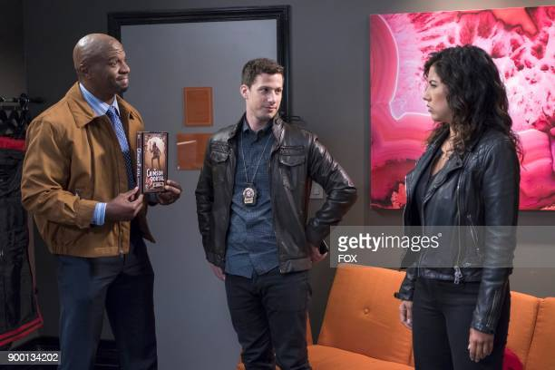 Terry Crews Andy Samberg and Stephanie Beatriz in the Return to Skyfire episode of BROOKLYN NINENINE airing Tuesday Nov 14 on FOX