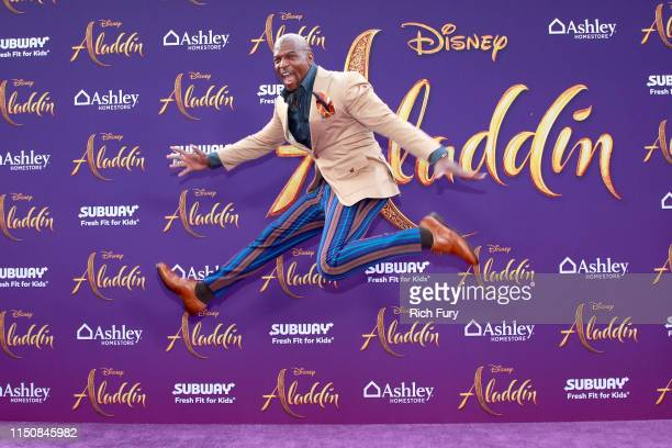 Terry Crews attends the premiere of Disney's Aladdin on May 21 2019 in Los Angeles California
