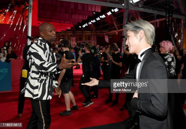 Terry Crews greets Taeyong of NCT 127 at the MTV EMAs 2019 at FIBES Conference and Exhibition Centre on November 03 2019 in Seville Spain