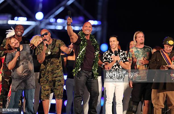 Terry Crews Jack Black Flo Rida Dwayne 'The Rock' Johnson Prince Royce Tommy Counihan and Jeff Ross perform onstage during 'Spike's Rock the Troops'...