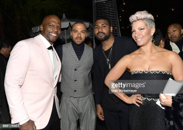 Terry Crews Jesse Williams GQ Style Editor Mark Anthony Green and Rebecca KingCrews attend the 2017 GQ Men of the Year party at Chateau Marmont on...