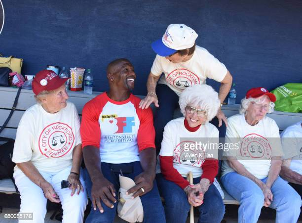 Terry Crews poses with original members of the All American Girls Professional Baseball League Dolly Konwinski Suzanne Zipay Maybelle Blair and...