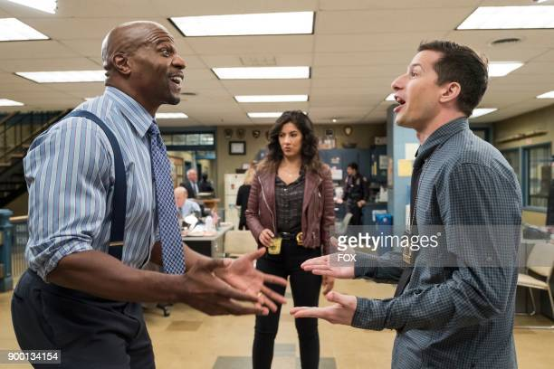 Terry Crews Stephanie Beatriz and Andy Samberg in the Return to Skyfire episode of BROOKLYN NINENINE airing Tuesday Nov 14 on FOX