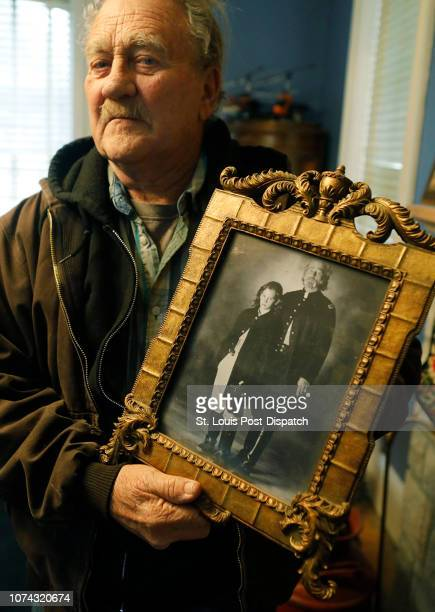 Terry Crowder shows off a picture of himself with his son Zachary Crowder who was 10 at the time on Thursday Nov 29 at the Division Cavalry Brigade...