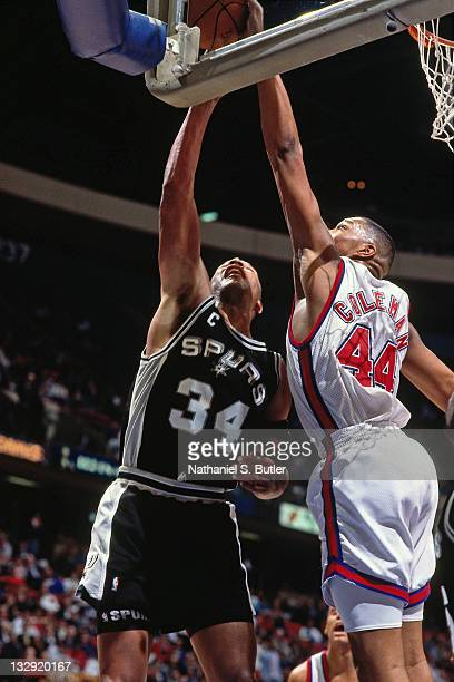 Terry Cummings of the San Antonio Spurs has his shot blocked by Derrick Coleman of the New Jersey Nets circa 1991 at the Brendan Byrne Arena in East...