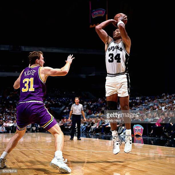 Terry Cummings of the San Antonio Spurs shoots a jumpshot from the baseline against the Utah Jazz during an NBA game on November 9 1994 at the Alamo...