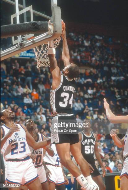 Terry Cummings of the San Antonio Spurs slam dunks the ball against the Washington Bullets during an NBA basketball game circa 1989 at the Capital...