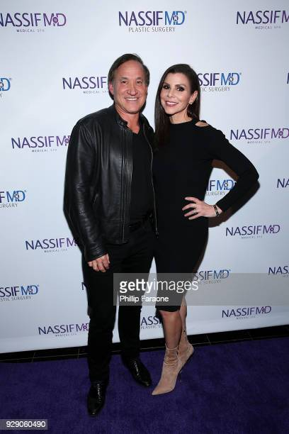Terry Dubrow and Heather Dubrow arrive for Dr Paul Nassif's unveiling of his new medical spa with grand opening and ribboncutting ceremony at Nassif...