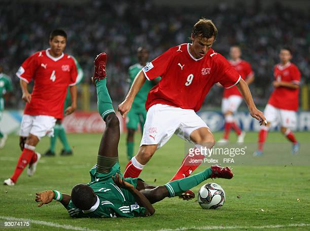 Terry Envoh of Nigeria and Haris Seferovic battle for the ball during the FIFA U17 World Cup Final between Switzerland and Nigeria at the Abuja...