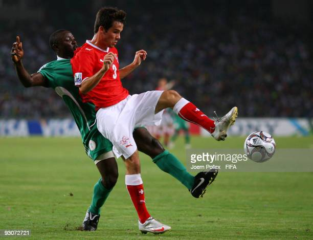 Terry Envoh of Nigeria and Janick Kamber of Switzerland battle for the ball during the FIFA U17 World Cup Final between Switzerland and Nigeria at...