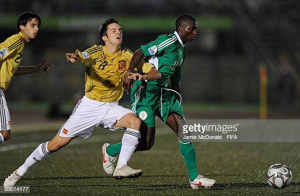 Terry Envoh of Nigeria holds off Sergi Roberto of Spain during the FIFA U17 World Cup SemiFinal 2 between Spain and Nigeria at the Teslim Balogun...