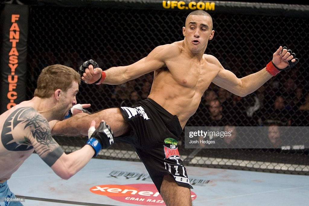 Terry Etim (black shorts) def. Brian Cobb (blue shorts) - TKO - :10 round 2 during UFC 95 at 02 Arena on February 21, 2009 in London, England.