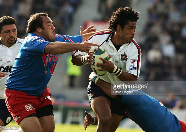 Terry Fanolua of Gloucester is tackled by Mathieu Blin during the Heineken Cup match between Stade Francais and Gloucester at Stade Jean Bouin on...