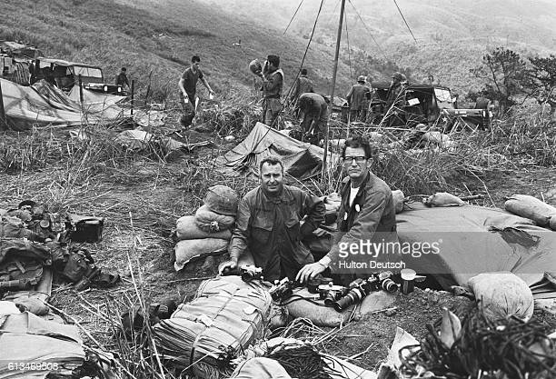 """Terry Fincher, of the Express, and Larry Burrows, of Life Magazine, follow US advances against the Vietcong from an encampment at """"Hill Timothy""""."""