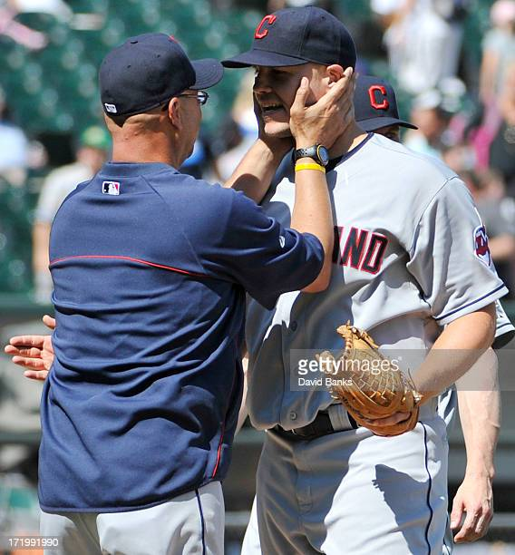 Terry Francona of the Cleveland Indians congratulates Justin Masterson after the Indians victory against the Chicago White Sox on June 30 2013 at US...