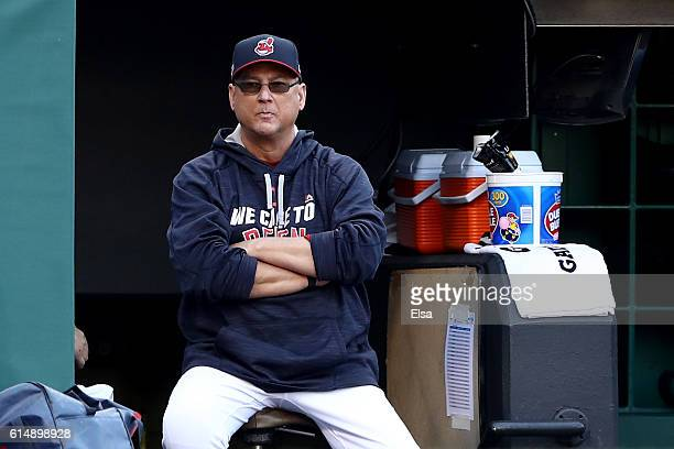 Terry Francona of the Cleveland Indians looks on from the dugout against the Toronto Blue Jays during game two of the American League Championship...