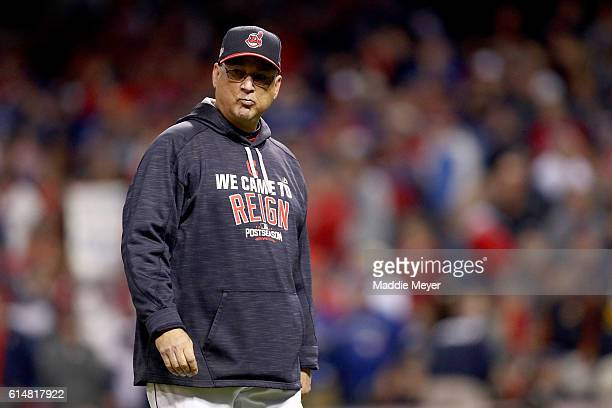 Terry Francona of the Cleveland Indians walks on the field against the Toronto Blue Jays during game one of the American League Championship Series...