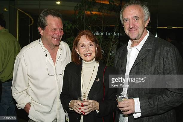 Terry Gilliam Katherine Hellman and Jonathan Pryce at a reception and screening of Lost in La Mancha for the opening night of the Terry Gilliam...