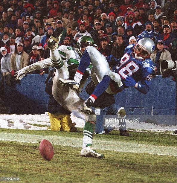 Terry Glenn and Jets Gary Jones collide