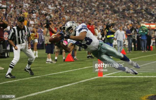 Terry Glenn of the Dallas Cowboys catches a pass for a touchdown in the second quarter against the Minnesota Vikings at Hubert H Humphrey Metrodome...