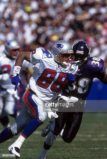 Terry Glenn of the New England Patriots runs on the field as Antonio Langham of the Baltimore Ravens shadows him during their game on October 6 1996...