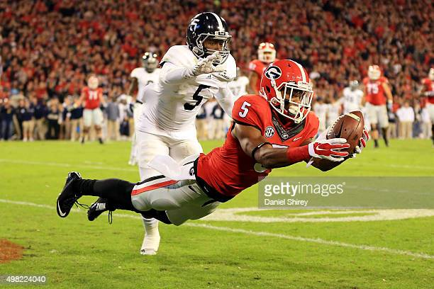 Terry Godwin of the Georgia Bulldogs catches a touchdown pass against Darius Jones of the Georgia Southern Eagles during the second half at Sanford...