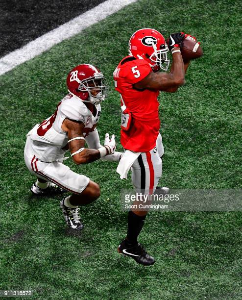 Terry Godwin of the Georgia Bulldogs makes a catch against Anthony Averett of the Alabama Crimson Tide in the CFP National Championship presented by...
