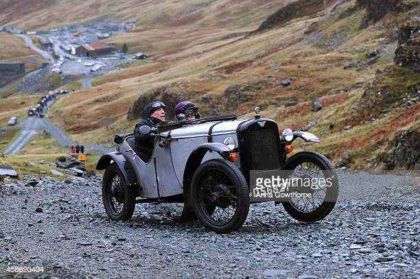 Terry Gosling drives his Austin 7 Sports Ulster Rep during a vintage car rally stage at the Honister Slate Mine on November 8 2014 in the Lake...
