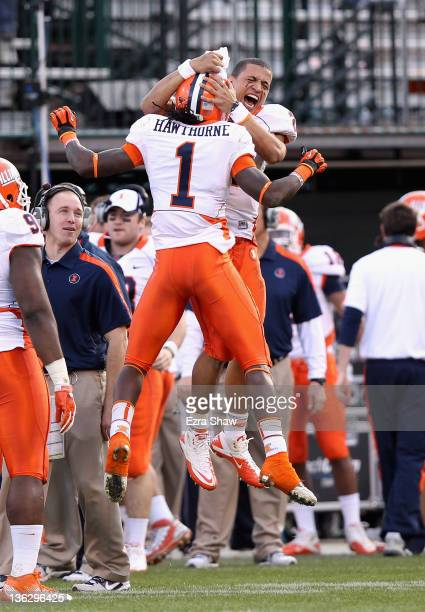Terry Hawthorne of the Illinois Fighting Illini is congratulated by Nathan Scheelhaase after he returned an interception for a touchdown against the...