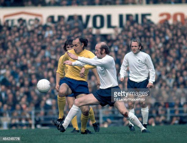 Terry Hennessy of Derby County challenges Alan Gilzean of Tottenham Hotspur during their Division One football match at The Baseball Ground in Derby...