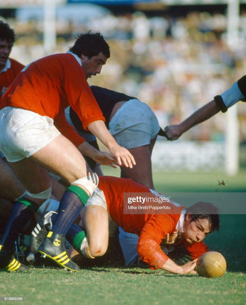 Terry Holmes of the British Lions passes from the ground whilst teammate Jeff Squire protects (left) during their match against Natal at King's Park Stadium in Durban on 17th May 1980. The British Lions won 21-15.