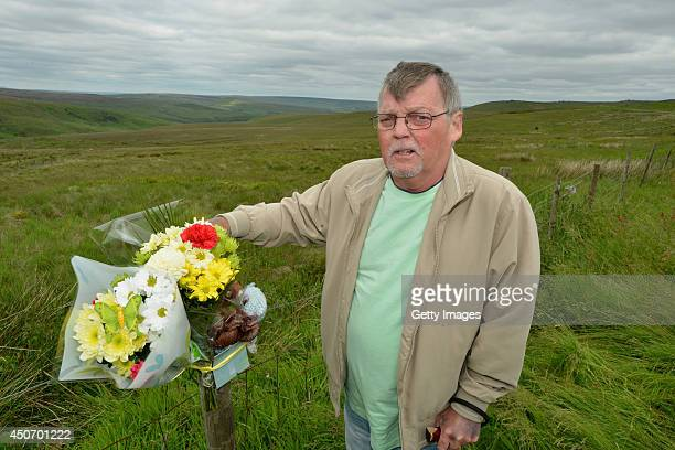 Terry Kilbride the brother moors murder victim John Kilbride places a floral tribute overlooking Saddleworth Moor where the body of missing Keith...