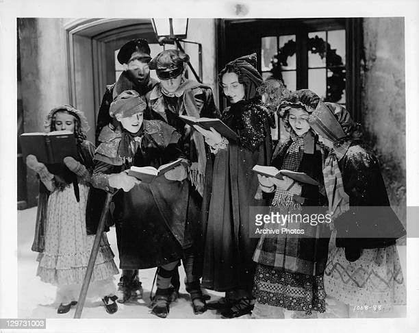 Terry Kilburn sings carols with other children in a scene from the film 'A Christmas Carol' 1938