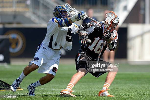 Terry Kimener of the Denver Outlaws battles against Casey Cittadino of the Charlotte Hounds during the 2013 MLL Semifinal game at PPL Park on August...