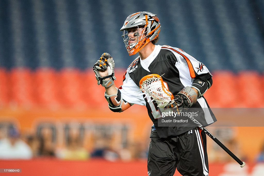 Terry Kimener #16 of the Denver Outlaws celebrates a goal against the Charlotte Hounds after a takeaway during a Major League Lacrosse game at Sports Authority Field at Mile High on June 29, 2013 in Denver, Colorado. The Outlaws beat the Hounds 17-11 and improved to 9-0 on the season.