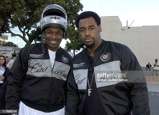 Terry Kirby and Donovan McNabb at the Cadillac Super Bowl Grand Prix an exclusive highgear SuperKart race where celebrities take it to the track to...