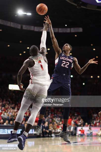 Terry Larrier of the Connecticut Huskies attempts a shot over Rawle Alkins of the Arizona Wildcats during the second half of the college basketball...