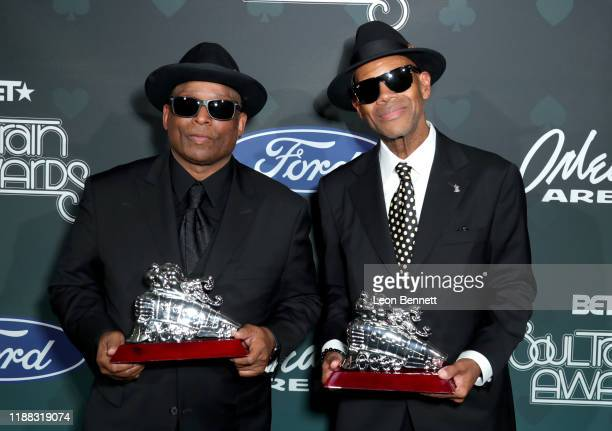 Terry Lewis and Jimmy Jam pose backstage at the 2019 Soul Train Awards presented by BET at the Orleans Arena on November 17, 2019 in Las Vegas,...