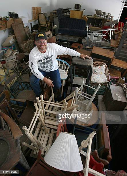 Terry Lipp pictured July 6 sits in his fivestall garage which is practically filled with furniture mostly from his ancestors