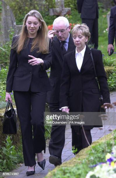 Terry Lloyd's daughter Chelsey and wife Lynn arrive with ITN editor David Mannion at St Nicholas Church Cuddington Buckinghamshire for the funeral of...